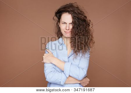 Portrait Of Thoughtful Contemplative Young Woman Purses Lips With Mysterious Expression, Looks In Be