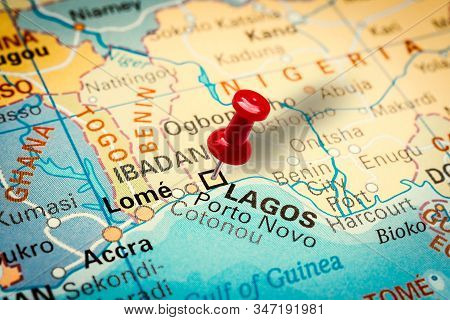 Prague, Czech Republic - January 12, 2019: Red Thumbtack In A Map. Pushpin Pointing At Lagos City In