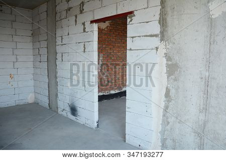 Interior Room Under Construction With Metal Door Lintels. Autoclaved Aerated Concrete  Wall Without