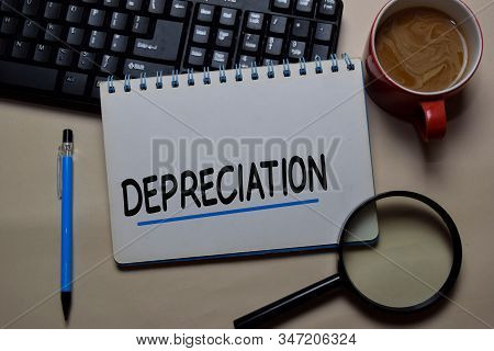 Depreciation Write On A Book Isolated On Office Desk.