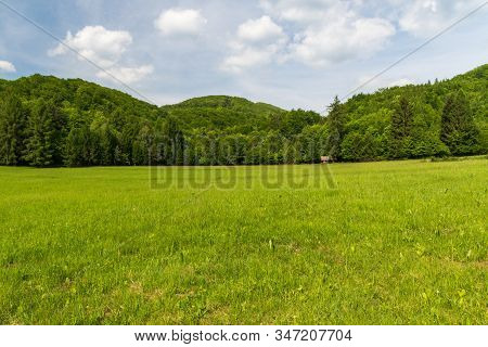 Springtime Velka Fatra Mountains Scenery With Meadow And Hills Covered By Deep Forest Above Krpelany