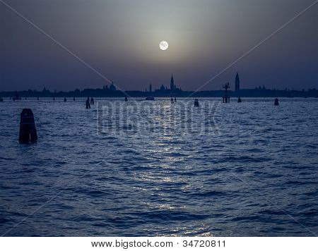 An image of the pale moon over Venice Italy