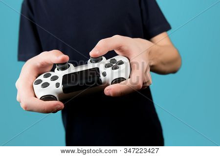White Modified Joystick From A Game Console In The Hands Of A Teenager. Close Up, No Face