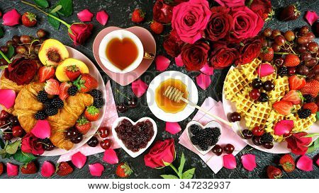 Romantic Indulgent Breakfast With Croissants, Pancakes, Waffles Fruit And Roses.