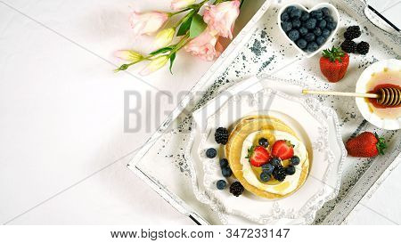 Pancake Breakfast Tray On Table With Syrup And Blueberries Fruit Flat Lay.