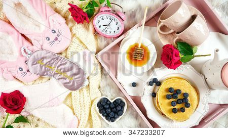 Pancake Breakfast Tray In Bed With Syrup And Blueberries Fruit Flat Lay.