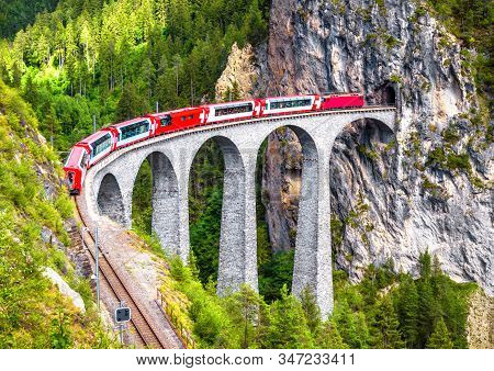 Landwasser Viaduct In Filisur, Switzerland. It Is Landmark Of Swiss Alps. Bernina Express Train On R