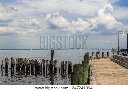 Keyport, New Jersey - June 2: A Man Fishing Off The Dock On Sandy Hook Bay On June 2 2018 In Keyport