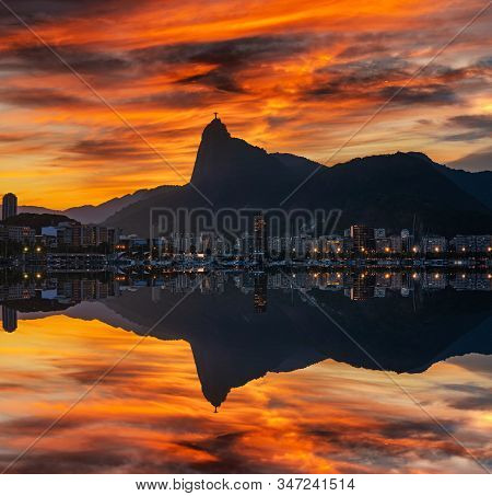 Beautiful Panorama Of Rio De Janeiro At Sunset, Brazil. Corcovado. Statue Of Christ The Redeemer