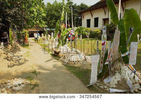 Luang Prabang, Laos - April, 14, 2012: Yard Of The Wat Visounnarath Temple With Small Sand Pagodas B