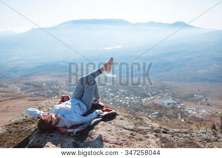 Young Girl Hipster Takes A Selfie On The Background Of Mountains. Video Communication. Nature Backgr