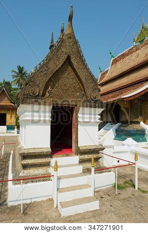 Luang Prabang, Laos - April 16, 2012: Exterior Of The Red Chapel With Famous Buddha Statues In Wat X
