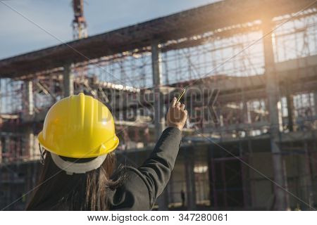 Construction Engineer And Safety & Health Officer Concept.young Woman Engineer Wear Safety Hat (helm
