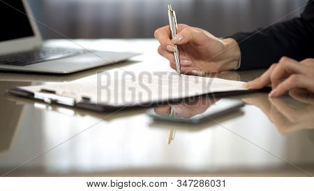 Woman In Suit Reading Terms And Conditions Of Agreement, Signing Contract