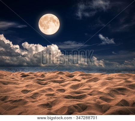 Sandy beach and moon at night