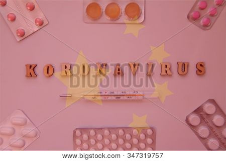 Coronavirus Word Of Wooden Letters On Backround With China Flag And Pills In Blisters. Global Health