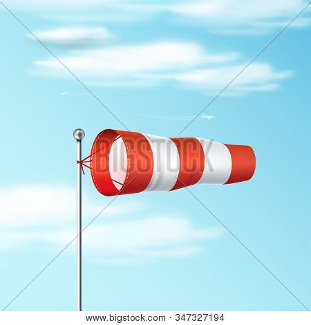 Windsock On The Blue Sky. Red And White Airport Wind Flag Showing Wind Direction And Speed. Realisti