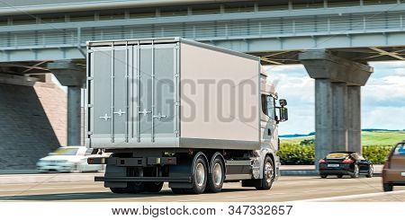 Back View Of White Truck With Empty Space On Refrigerator Driving Along The Route. 3d Rendering