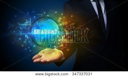 Elegant hand holding BROADBAND inscription, digital technology concept