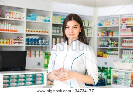 Attractive Woman Pharmacist Use Hand Gesture And Looks Smart And Confident. Pharmacy Or Drug Adverti