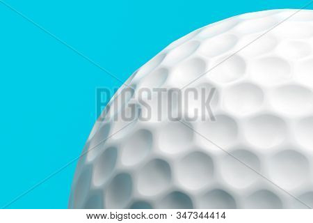 Close Up Of Golf Ball Isolated On Blue Background. 3d Rendering