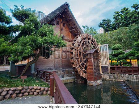 Kowloon, Hong Kong - November 3 2017: The Old Water Mill, To Be Seen In The Nan Lian Garden In Hong