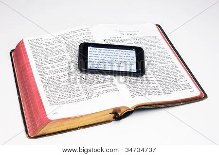Worn Bible And Smartphone - John