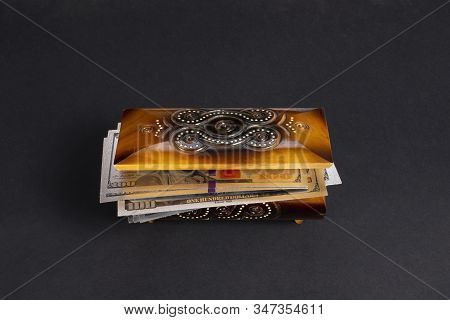 Silver Dollar Banknots In The Treasure Trove, Wooden Chest, Gift, Decoration On Dark Paper Backgroun