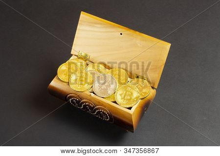 Golden Bitcoin Coins In The Treasure Trove, Cryptocurrency In Wooden Chest, Gift, Decoration On Blac