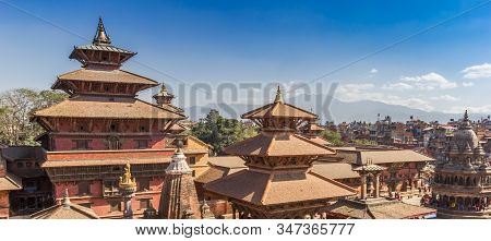 Panorama Of Temples On Durbar Square With Mountain Background In Patan, Nepal