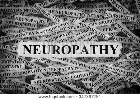 Neuropathy. Torn Pieces Of Paper With The Words Neuropathy. Concept Image. Black And White. Close Up