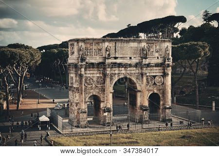 ROME - MAY 12: Arch of Constantine with tourists on May 12, 2016 in Rome, Italy. Rome ranked 14th in the world, 3rd in European Union, and 1st the most popular tourism attraction in Italy.
