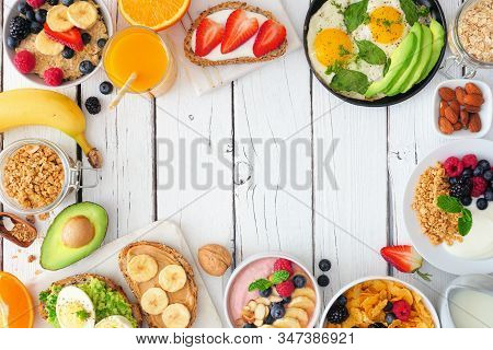 Healthy Breakfast Food Frame. Table Scene With Fruit, Yogurt, Smoothie, Oatmeal, Nutritious Toasts A