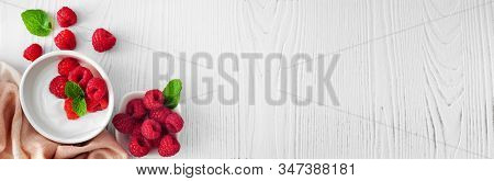 Healthy Yogurt With Raspberries. Banner With Corner Border Against A Rustic White Wood Background. C