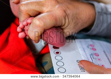 Close Up Details As A Family Doctor Carries Out A Heel Prick Blood Test During Newborn Baby Health S
