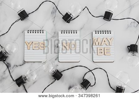 Decision Making Process Conceptual Still-life, Group Of Notepads With Yes No And Maybe Options And S