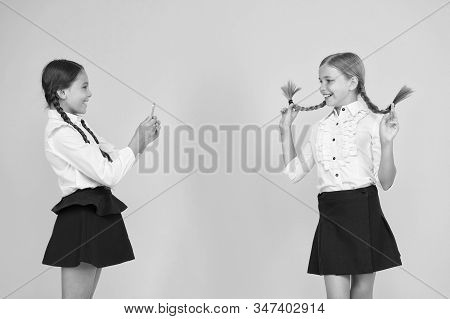 School Girls Use Smartphone To Take Photo. Girls School Uniform. Personal Blog. Dont Give Anyone You