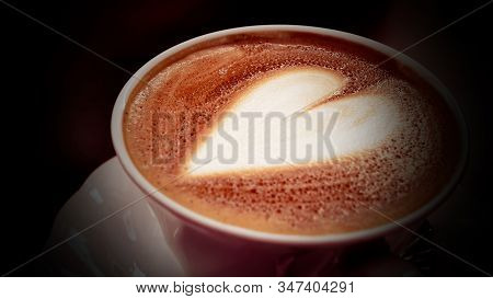 Close Up Cappuccino Coffee Heart Shape In White Cup.