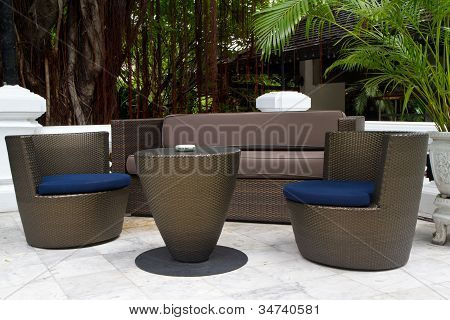 black rattan table and chairs