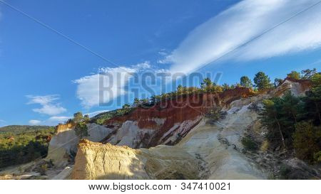 Roussillon, Red Rocks Of Colorful Ochre Canyon In Provence, Landscape Of France.