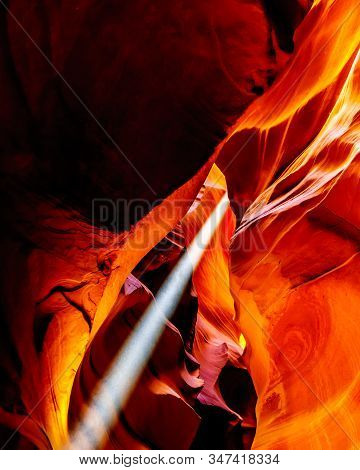 Sun Rays Entering In Upper Antelope Canyon Smooth Curved Red Navajo Sandstone Walls Of The Canyon. U