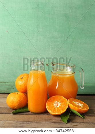 Group Of Fresh Orange And Juice On Wooden Table