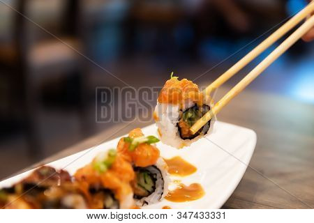 Sushi Rolls Japanese Delicacy. Japanese Traditional Food From Rice And Fish. Beautiful Serving Of Fo