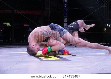 Odessa, Ukraine-june 30, 2019: Fighters Of Mma Boxers Are Fighting Without Rules In Cage Ring Of Oct