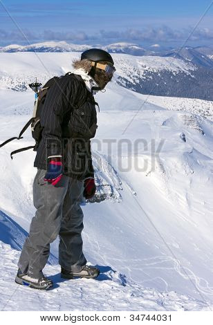 Backcountry freerider on the brink of a precipice