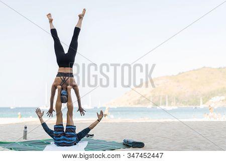 Adult Couple On The Beach Senor Zanimabtsya Steamy Yoga. Trust Relationship Balance