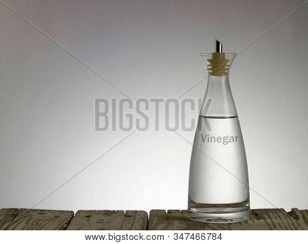 white vinegar on the gray background