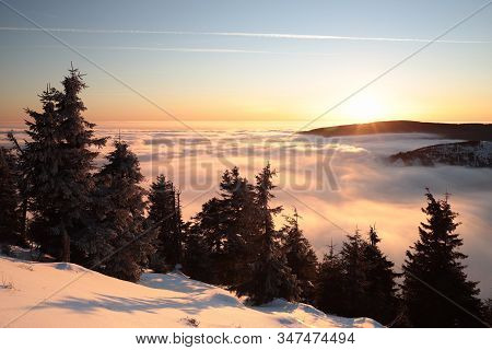 Winter landscape mountains dusk clouds Nature background sunset suneise sun Nature background panorama Nature background winter snow Nature background hiking path pine spruce tree Nature background orange Nature background peak summit Nature background.
