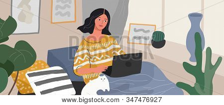 Cute Woman Sitting On Chair With Laptop In Cozy Scandinavian Home Interior. Girl With A Cat Relaxing