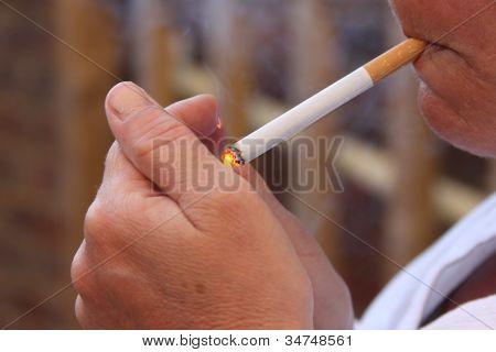 Woman Lighting a Cigarette